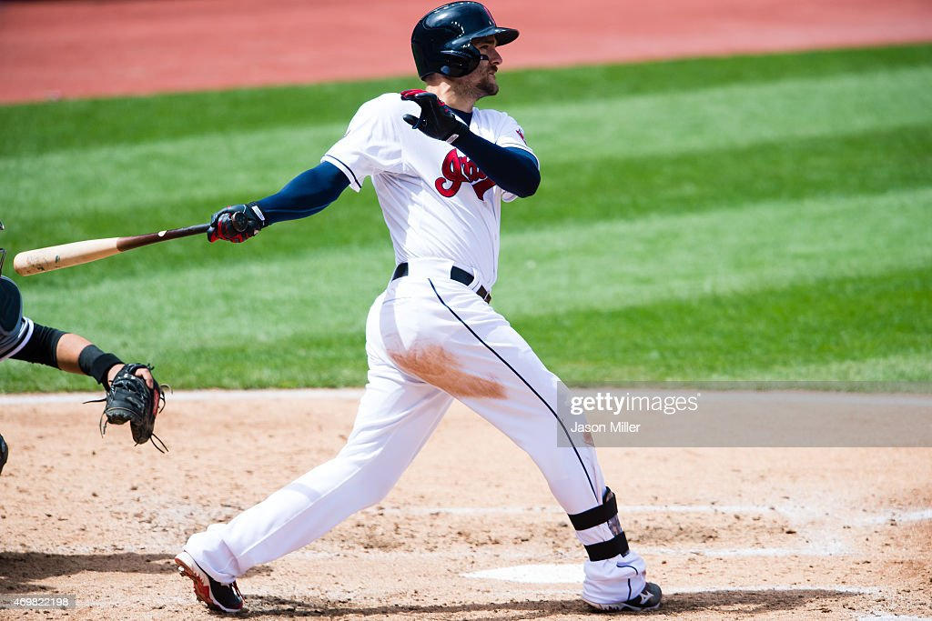 Lonnie Chisenhall of the Cleveland Indians hits a two RBI double during the fourth inning against the Chicago White Sox at Progressive Field on April...