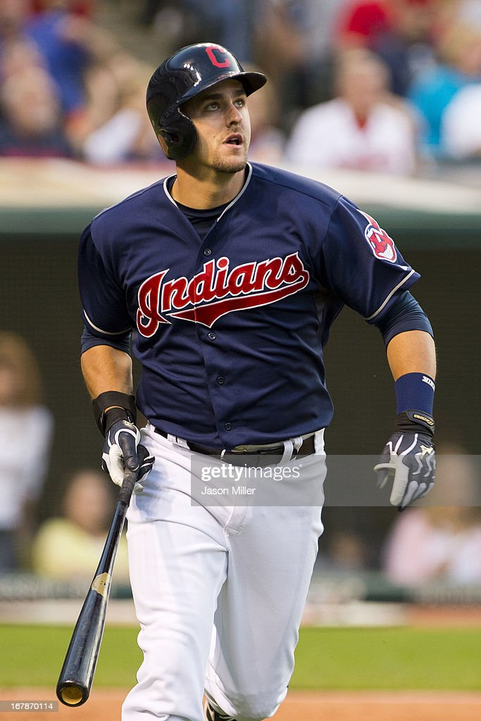 Lonnie Chisenhall of the Cleveland Indians hits a two run home run during the fourth inning against the Philadelphia Phillies at Progressive Field on...