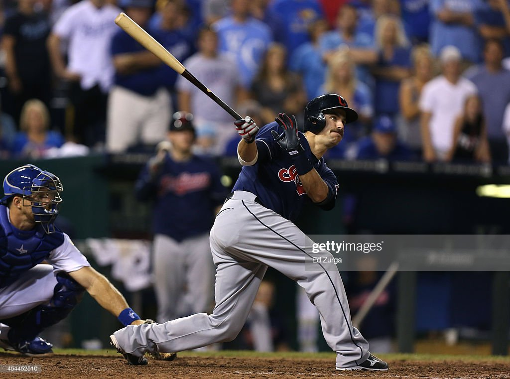 Lonnie Chisenhall #8 of the Cleveland Indians hits a two-run double in the 10th inning against the Kansas City Royals at Kauffman Stadium on August 31, 2014 in Kansas City, Missouri.