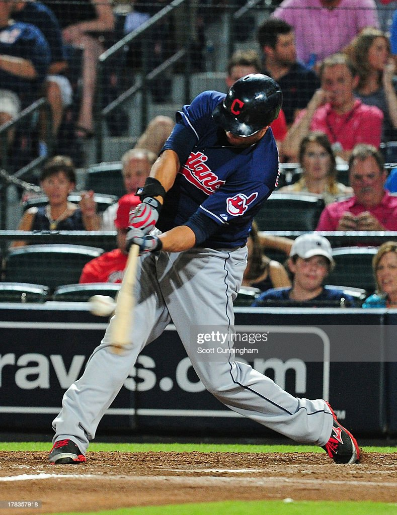 Lonnie Chisenhall #8 of the Cleveland Indians hits an eighth inning home run against the Atlanta Braves at Turner Field on August 29, 2013 in Atlanta, Georgia.