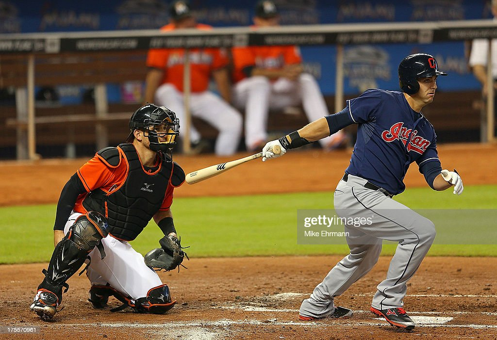 <a gi-track='captionPersonalityLinkClicked' href=/galleries/search?phrase=Lonnie+Chisenhall&family=editorial&specificpeople=6796448 ng-click='$event.stopPropagation()'>Lonnie Chisenhall</a> #8 of the Cleveland Indians hits an RBI double during a game against the Miami Marlins at Marlins Park on August 4, 2013 in Miami, Florida.