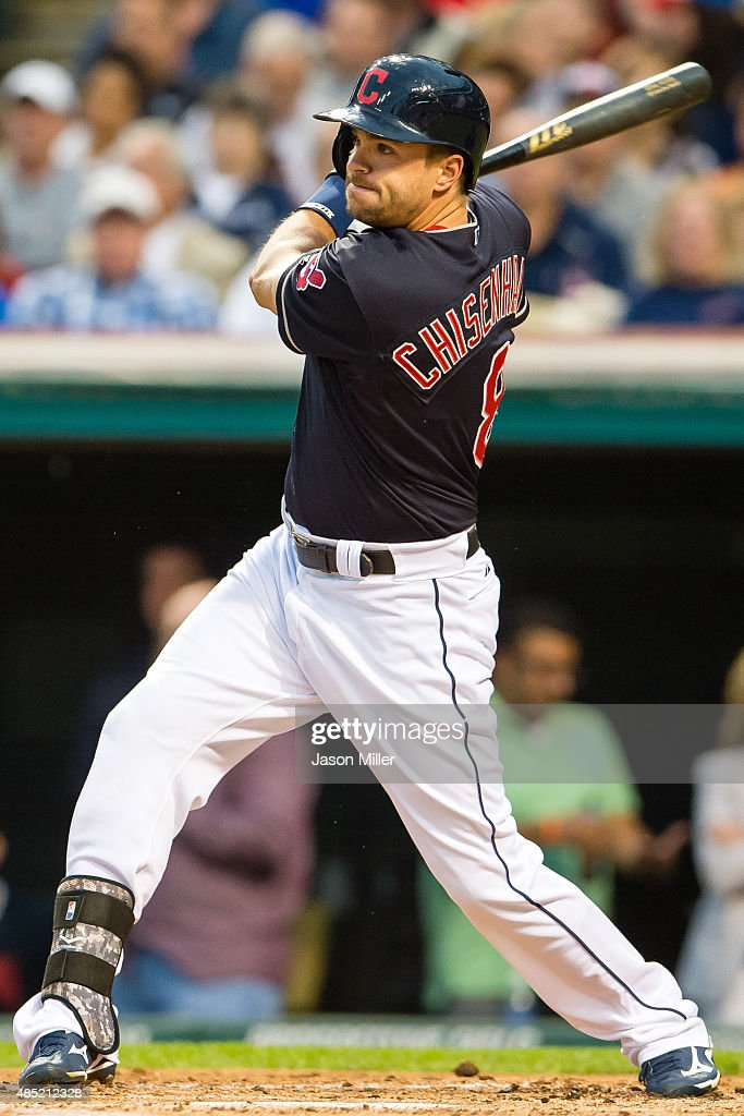 Lonnie Chisenhall of the Cleveland Indians hits an RBI single during the first inning against the Milwaukee Brewers at Progressive Field on August 25...