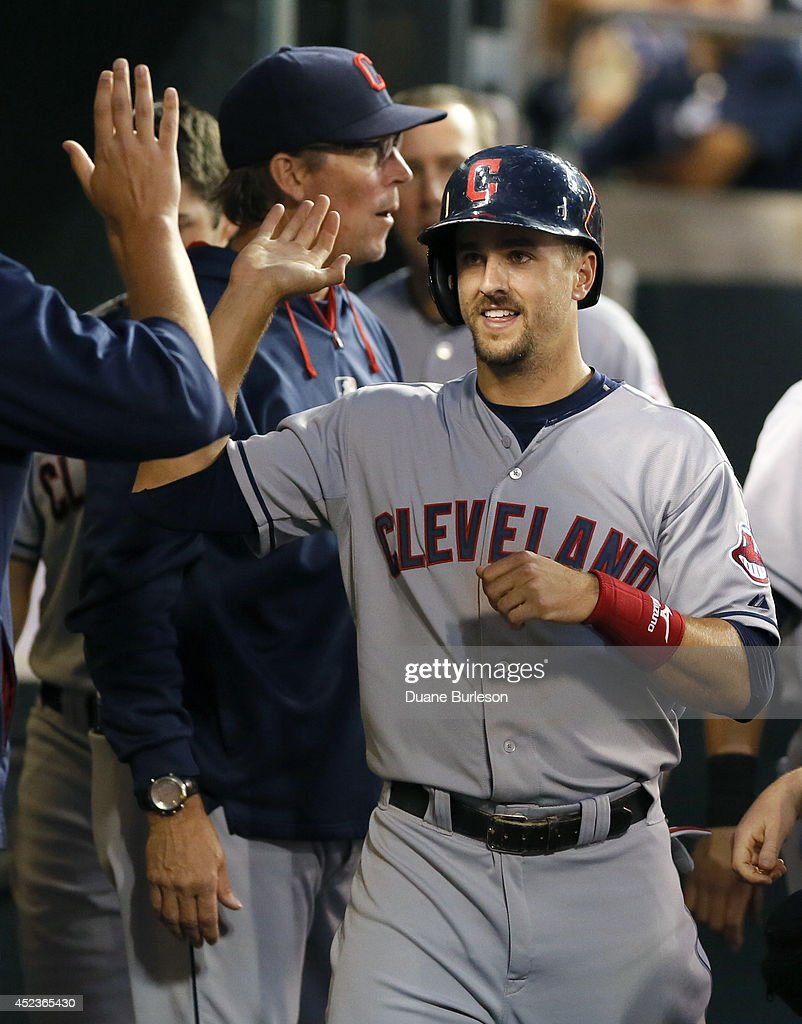 Lonnie Chisenhall of the Cleveland Indians is congratulated after scoring on a double by Ryan Raburn during the seventh inning at Comerica Park on...