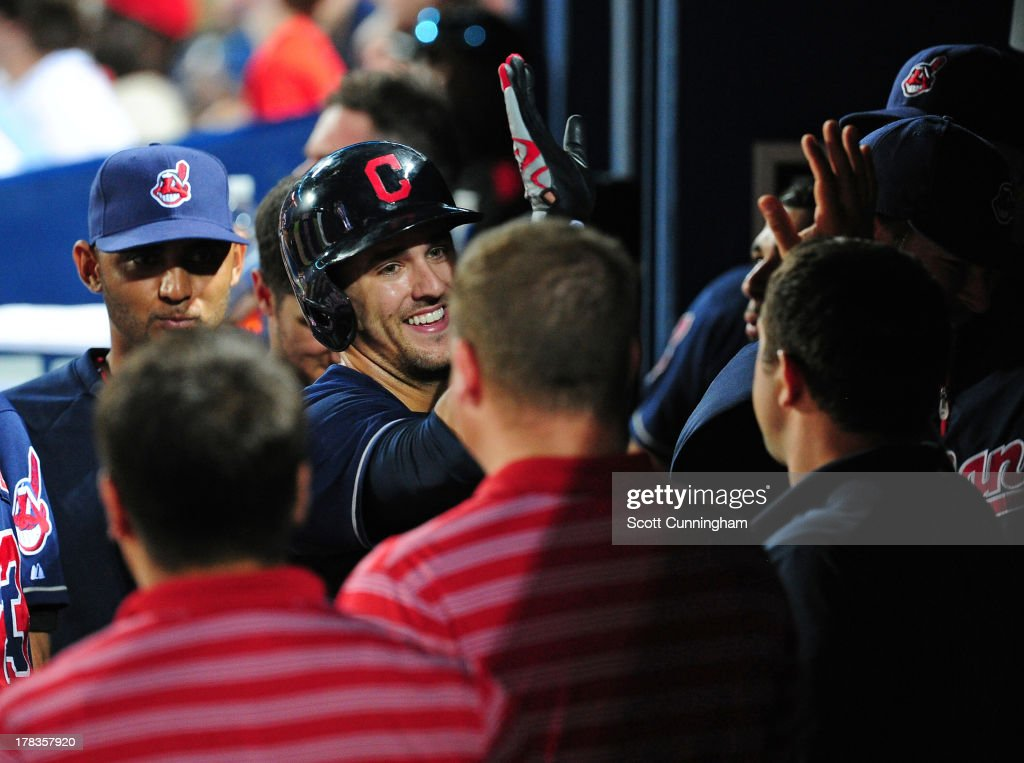 Lonnie Chisenhall #8 of the Cleveland Indians is congratulated by teammates after hitting an eighth inning home run against the Atlanta Braves at Turner Field on August 29, 2013 in Atlanta, Georgia.