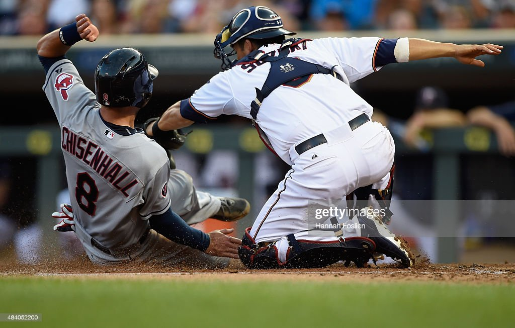 Lonnie Chisenhall of the Cleveland Indians is out as Kurt Suzuki of the Minnesota Twins defends home plate during the second inning of the game on...