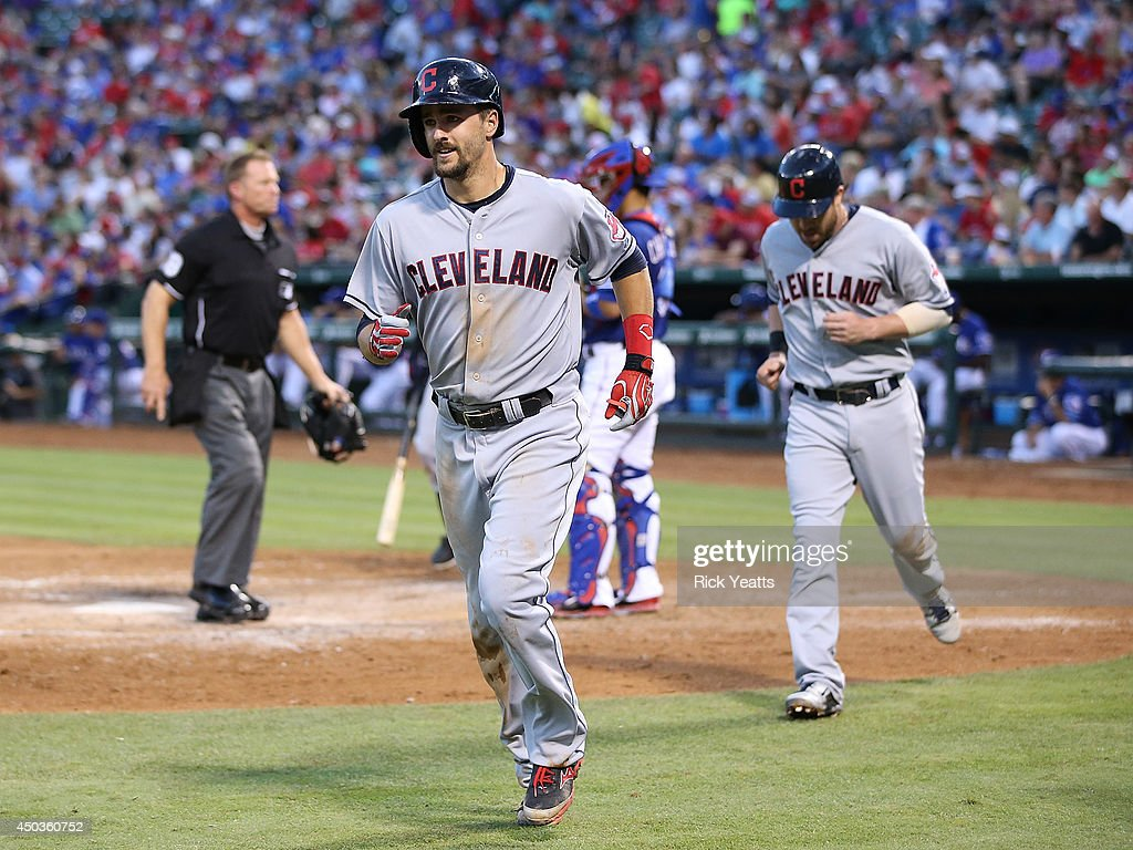 Lonnie Chisenhall of the Cleveland Indians jogs to the dugout after hitting a tworun home run in the fourth inning against the Texas Rangers at Globe...