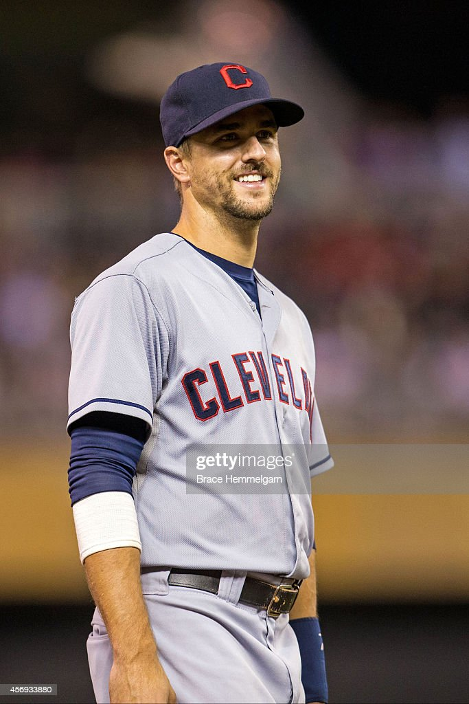 Lonnie Chisenhall of the Cleveland Indians looks on against the Minnesota Twins on September 19 2014 at Target Field in Minneapolis Minnesota The...