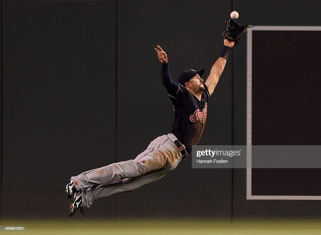 Lonnie Chisenhall of the Cleveland Indians misses a catch of on a ball off the bat of Aaron Hicks of the Minnesota Twins that went for a double in...