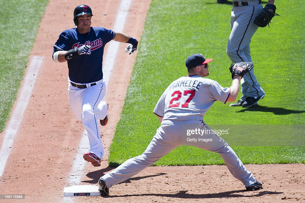 Lonnie Chisenhall #8 of the Cleveland Indians reaches first on an infield hit to second as first baseman Chris Parmelee #27 of the Minnesota Twins waits for the throw during the third inning at Progressive Field on May 5, 2013 in Cleveland, Ohio. The Twins defeated the Indians 4-2.