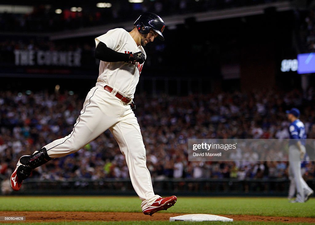 Lonnie Chisenhall of the Cleveland Indians rounds the bases after hitting a three run home run against the Toronto Blue Jays during the fourth inning...
