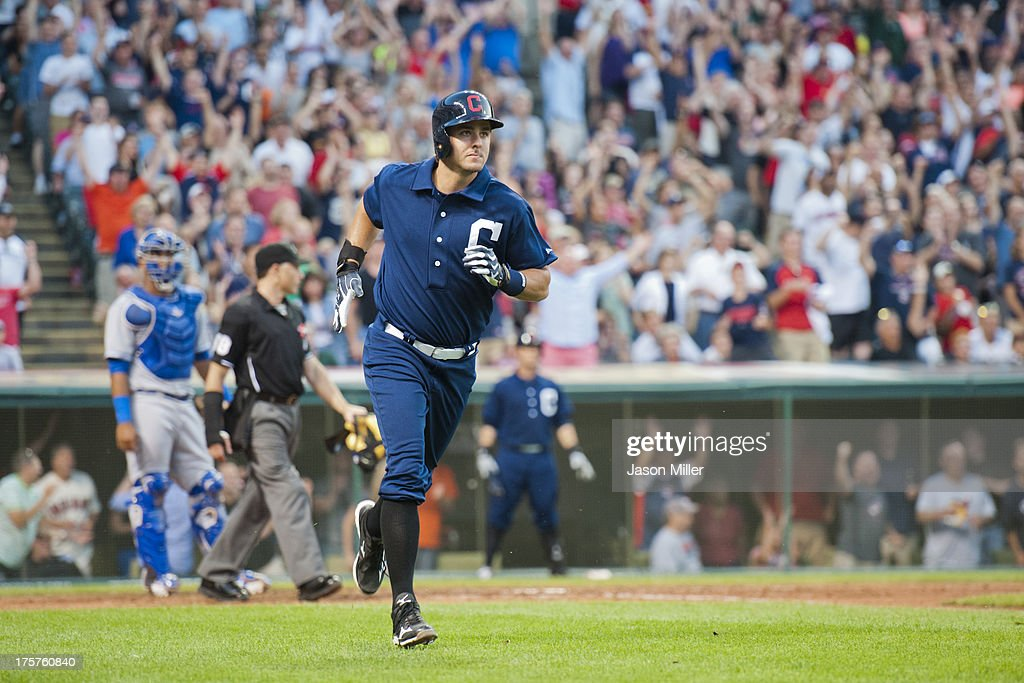 Lonnie Chisenhall of the Cleveland Indians runs the bases after hitting a grand slam home run during the sixth inning against the Kansas City Royals...