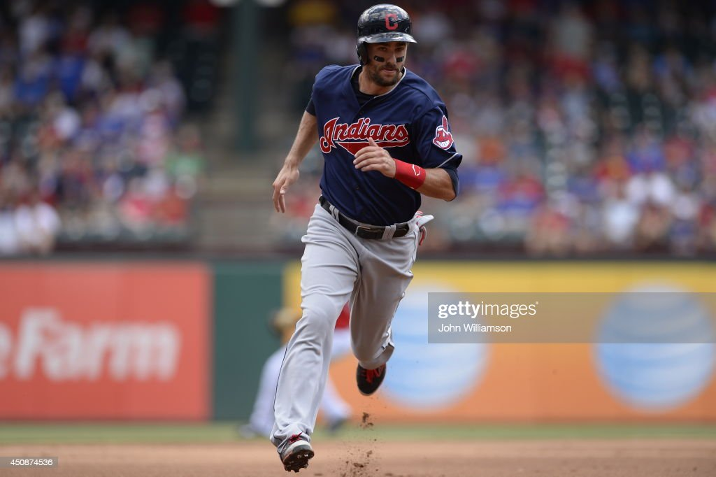 Lonnie Chisenhall #8 of the Cleveland Indians runs the bases as he advances to third base in the game against the Texas Rangers at Globe Life Park in Arlington on June 7, 2014 in Arlington, Texas. The Cleveland Indians defeated the Texas Rangers 8-3.
