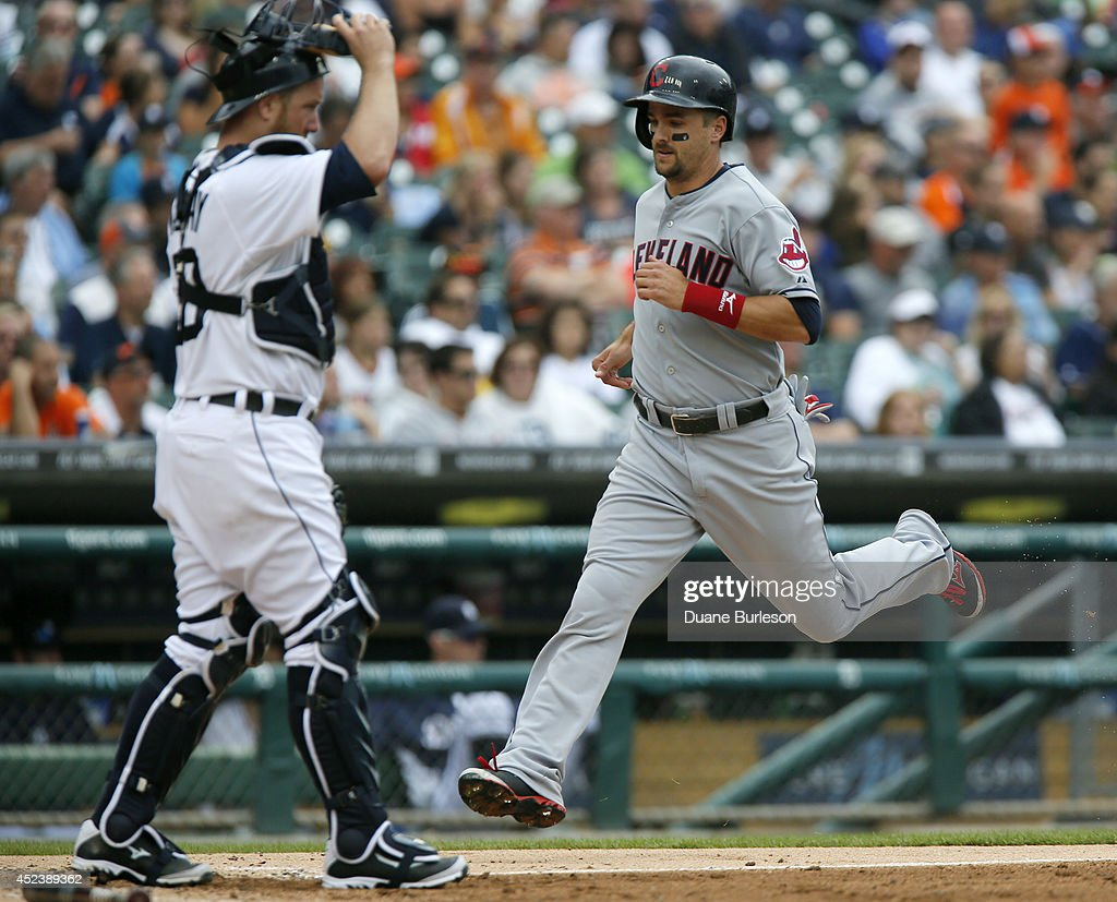<a gi-track='captionPersonalityLinkClicked' href=/galleries/search?phrase=Lonnie+Chisenhall&family=editorial&specificpeople=6796448 ng-click='$event.stopPropagation()'>Lonnie Chisenhall</a> #8 of the Cleveland Indians scores past <a gi-track='captionPersonalityLinkClicked' href=/galleries/search?phrase=Bryan+Holaday&family=editorial&specificpeople=7511226 ng-click='$event.stopPropagation()'>Bryan Holaday</a> #50 of the Detroit Tigers on a double by Nick Swisher during the fifth inning of game one of a doubleheader at Comerica Park on July 19, 2014 in Detroit, Michigan.