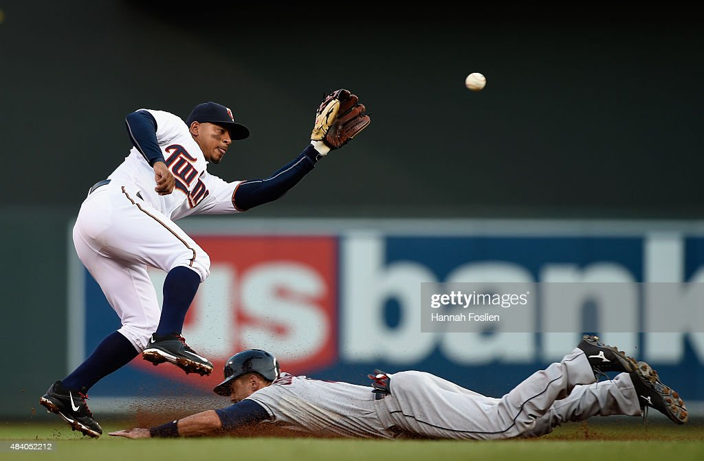 <a gi-track='captionPersonalityLinkClicked' href=/galleries/search?phrase=Lonnie+Chisenhall&family=editorial&specificpeople=6796448 ng-click='$event.stopPropagation()'>Lonnie Chisenhall</a> #8 of the Cleveland Indians steals second base as <a gi-track='captionPersonalityLinkClicked' href=/galleries/search?phrase=Eduardo+Escobar&family=editorial&specificpeople=7522733 ng-click='$event.stopPropagation()'>Eduardo Escobar</a> #5 of the Minnesota Twins fields the ball during the second inning of the game on August 14, 2015 at Target Field in Minneapolis, Minnesota.
