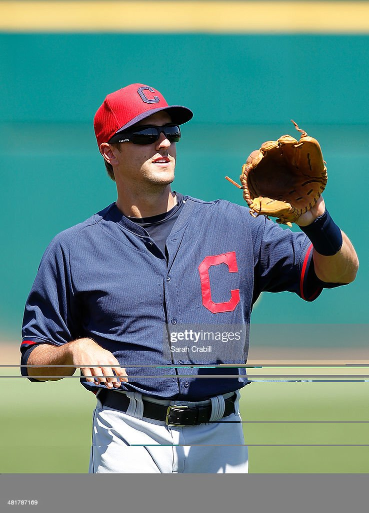 Lonnie Chisenhall of the Cleveland Indians warms up before a game against the Cincinnati Reds at Goodyear Ballpark on March 24 2014 in Goodyear...