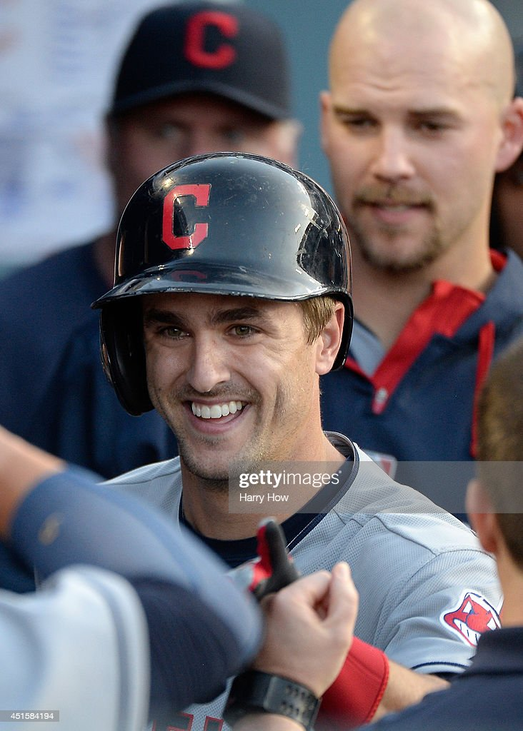 <a gi-track='captionPersonalityLinkClicked' href=/galleries/search?phrase=Lonnie+Chisenhall&family=editorial&specificpeople=6796448 ng-click='$event.stopPropagation()'>Lonnie Chisenhall</a> #8 reacts to his two run homerun in the dugout to take a 3-0 lead over the Los Angeles Dodgers during the first inning at Dodger Stadium on July 1, 2014 in Los Angeles, California.