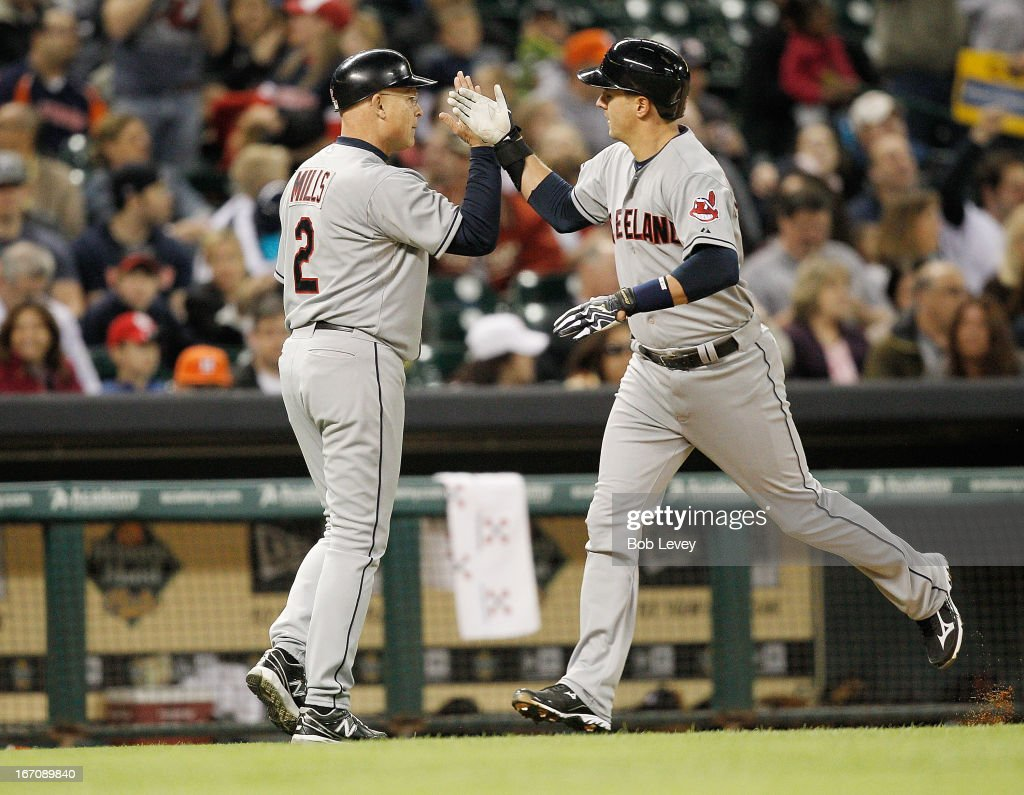 <a gi-track='captionPersonalityLinkClicked' href=/galleries/search?phrase=Lonnie+Chisenhall&family=editorial&specificpeople=6796448 ng-click='$event.stopPropagation()'>Lonnie Chisenhall</a> #8 receives a high five from third base coach Brad Mills #2 after hitting a home run in the fourth inning against the Houston Astros at Minute Maid Park on April 19, 2013 in Houston, Texas.