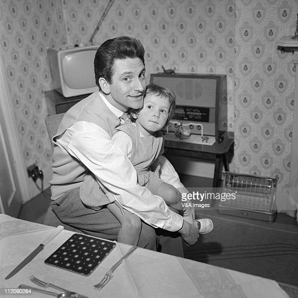 Lonnie Donegan posed with child at home 1960