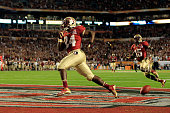 Lonnie Pryor and Greg Dent of the Florida State Seminoles celebrate after Pryor scored a 60yard rushing touchdown in the first quarter against the...