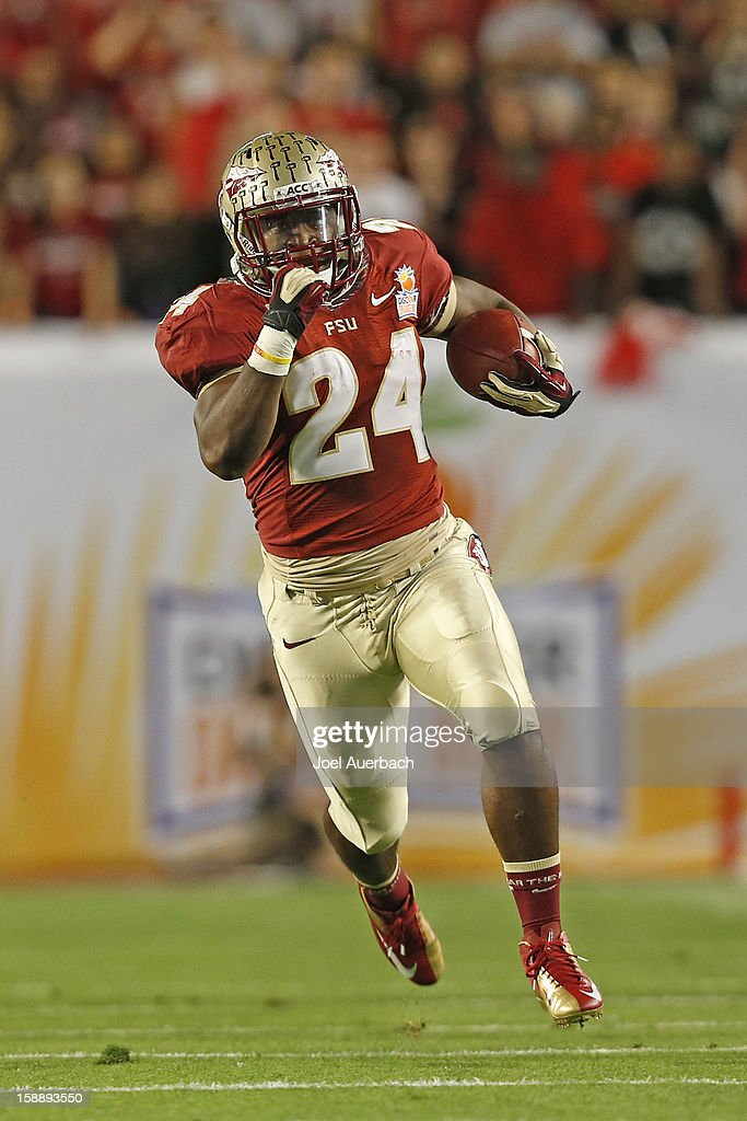 Lonnie Pryor #24 of the Florida State Seminoles runs 60 yards for a first quarter touchdown against the Northern Illinois Huskies during the 2013 Discover Orange Bowl at Sun Life Stadium on January 1, 2013 in Miami, Florida. The Seminoles defeated the Huskies 31-10.