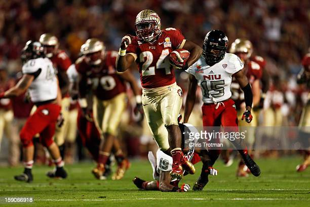 Lonnie Pryor of the Florida State Seminoles scores a 37yard rushing touchdown in the fourth quarter against the Northern Illinois Huskies during the...