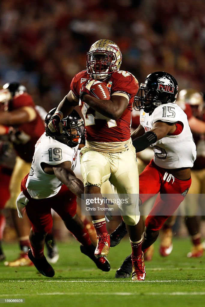 Lonnie Pryor #24 of the Florida State Seminoles scores a 37-yard rushing touchdown in the fourth quarter against the Northern Illinois Huskies during the Discover Orange Bowl at Sun Life Stadium on January 1, 2013 in Miami Gardens, Florida.