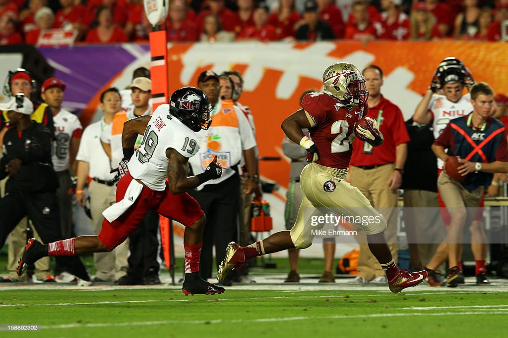 Lonnie Pryor #24 of the Florida State Seminoles scores a 60-yard rushing touchdown in the first quarter against Demetrius Stone #19 of the Northern Illinois Huskies during the Discover Orange Bowl at Sun Life Stadium on January 1, 2013 in Miami Gardens, Florida.