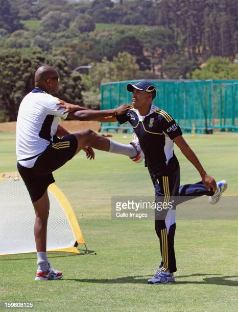 Lonwabo Tsotsobe and Aaron Phangiso attend the South African national cricket team nets session and press conference at Claremont Cricket Club on...