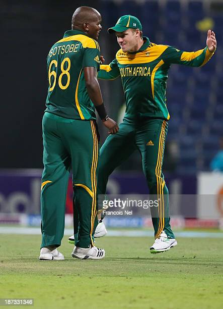 Lonwabo Tsotsobe and David Miller of South Africa share a light moment on the field during the third One Day International between Pakistan and South...