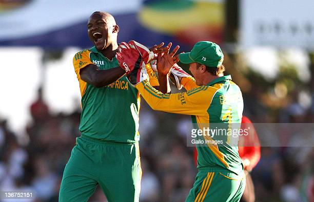 Lonwabo Tsotsobe of South Africa celebrates a wicket with South African captain AB de Villiers during the 1st One Day International match between...
