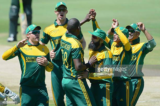 Lonwabo Tsotsobe of South Africa celebrates the wicket of Asad Shafiq of Pakistan with his teammates during the 3rd One Day International match...