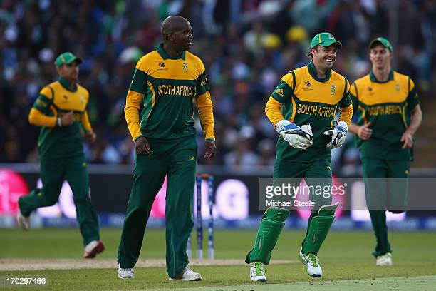 Lonwabo Tsotsobe of South Africa celebrates with AB de Villiers after capturing the wicket of Misbah ul Haq of Pakistan during the ICC Champions...