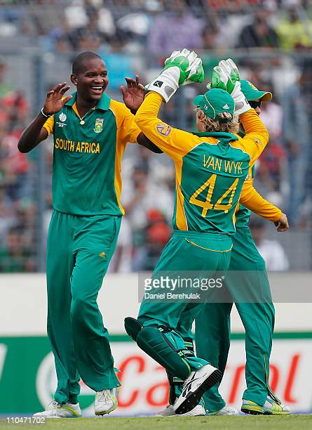 Lonwabo Tsotsobe of South Africa celebrates with team mates after taking the wicket of Imrul Kayes of Bangladesh during the ICC World Cup Cricket...