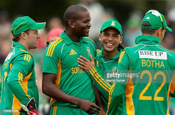 Lonwabo Tsotsobe of South Africa celebrates with team mates during the friendly Twenty20 match between the Christchurch Wizards and South Africa at...