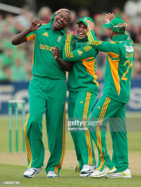 Lonwabo Tsotsobe of South Africa celebrates with team mates Justin Ontong and JP Duiny during the friendly Twenty20 match between the Christchurch...