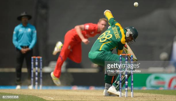 Lonwabo Tsotsobe of South Africa ducks into a delivery from England bowler Stuart Broad and is caught behind during the ICC Champions Trophy Semi...