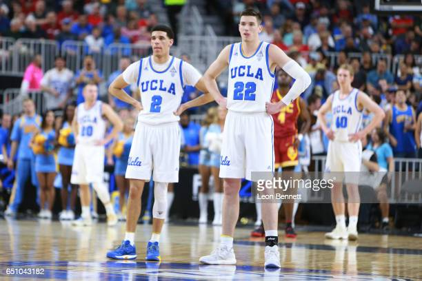 Lonzo Ball and TJ Leaf of the UCLA Bruins looking on during a time out against the USC Trojans during a quarterfinal game of the Pac12 Basketball...