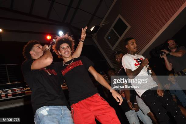Lonzo Ball LaMelo Ball and Kenneth Paige perform onstage at Melo Ball's 16th Birthday on September 2 2017 in Chino California