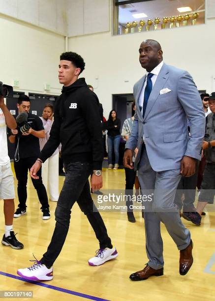 Lonzo Ball looks on and Magic Johnson president of basketball operations of the Los Angeles Lakers arrive for a press conference on June 23 2017 at...