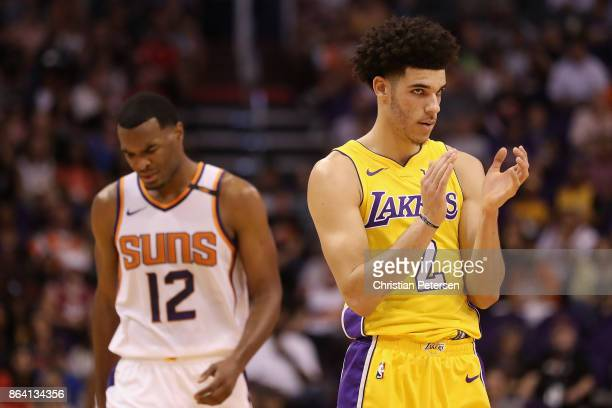 Lonzo Ball of the Los Angeles Lakers applauds after a call ahead of TJ Warren of the Phoenix Suns during the first half of the NBA game at Talking...