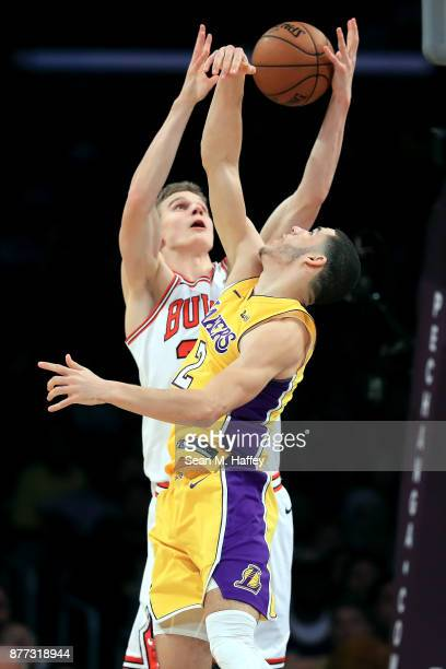 Lonzo Ball of the Los Angeles Lakers battles Lauri Markkanen of the Chicago Bulls for a rebound during the second half of a game at Staples Center on...