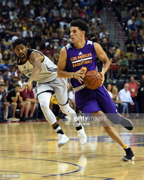 Lonzo Ball of the Los Angeles Lakers brings the ball up the court ahead of Spencer Dinwiddie of the Brooklyn Nets during the 2017 Summer League at...