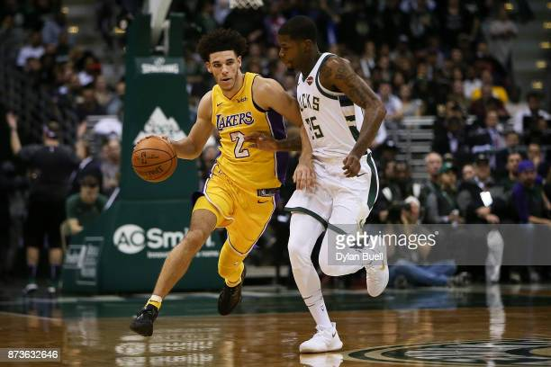 Lonzo Ball of the Los Angeles Lakers dribbles the ball while being guarded by DeAndre Liggins of the Milwaukee Bucks in the fourth quarter at the...