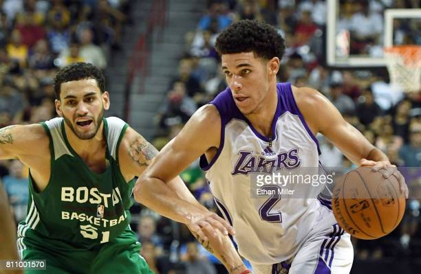Lonzo Ball of the Los Angeles Lakers drives against Abdel Nader of the Boston Celtics during the 2017 Summer League at the Thomas Mack Center on July...