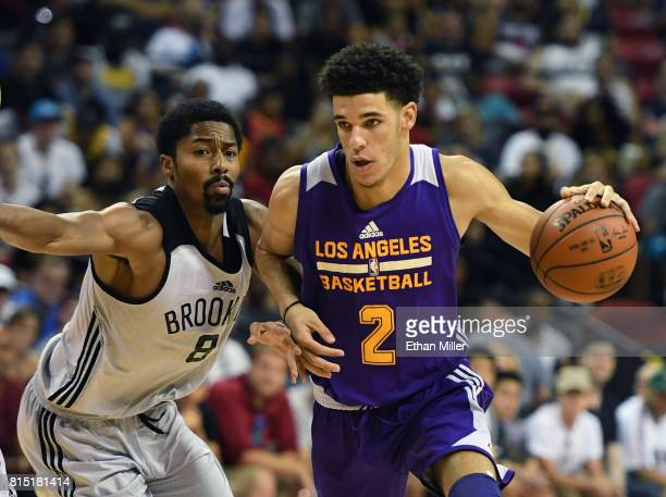 Lonzo Ball of the Los Angeles Lakers drives against Spencer Dinwiddie of the Brooklyn Nets during the 2017 Summer League at the Thomas Mack Center on...