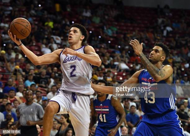 Lonzo Ball of the Los Angeles Lakers drives to the basket against Jonah Bolden of the Philadelphia 76ers during the 2017 Summer League at the Thomas...