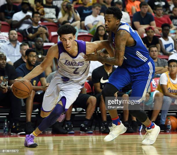 Lonzo Ball of the Los Angeles Lakers drives to the basket against Isaiah Miles of the Philadelphia 76ers during the 2017 Summer League at the Thomas...