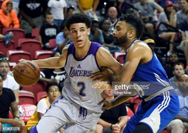 Lonzo Ball of the Los Angeles Lakers drives to the basket against James Blackmon Jr #19 of the Philadelphia 76ers during the 2017 Summer League at...