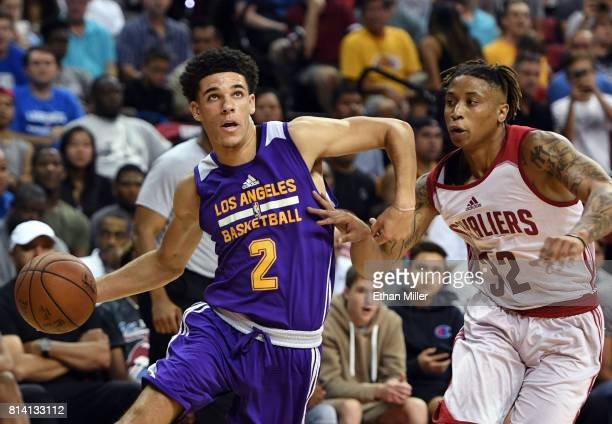Lonzo Ball of the Los Angeles Lakers drives to the basket against TJ Williams of the Cleveland Cavaliers during the 2017 Summer League at the Thomas...