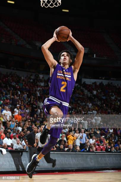Lonzo Ball of the Los Angeles Lakers goes to the basket against the Cleveland Cavaliers on July 13 2017 at the Thomas Mack Center in Las Vegas Nevada...